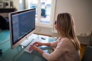 Freelance Programmer at her desk