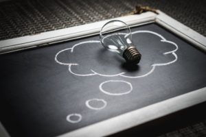 Lightbulb on chalkboard representing an idea.