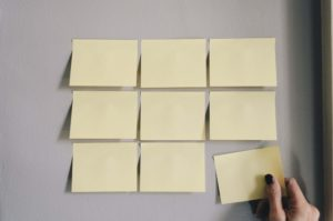 Yellow post-it notes on a wall ready to set out a routine.