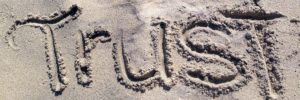 Trust written in the sand can wash away, but trust signals are powerful long-term factors for building freelance credibility.